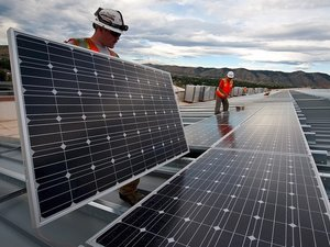 men laying solar panels