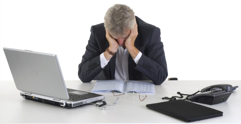 man stressed with computer